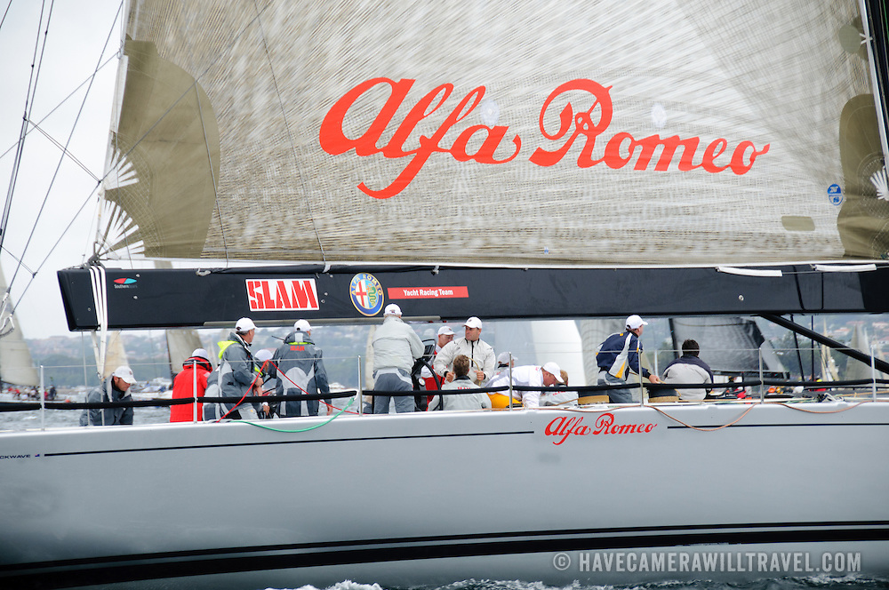 Super maxi yach Alfa Romeo at the start of the 2009 Rolex Sydney to Harbour Yacht Race in Sydney Harbour. Alfa Romeo was the eventual winner on overall line honors.. It was skippered by Neville Crichton.