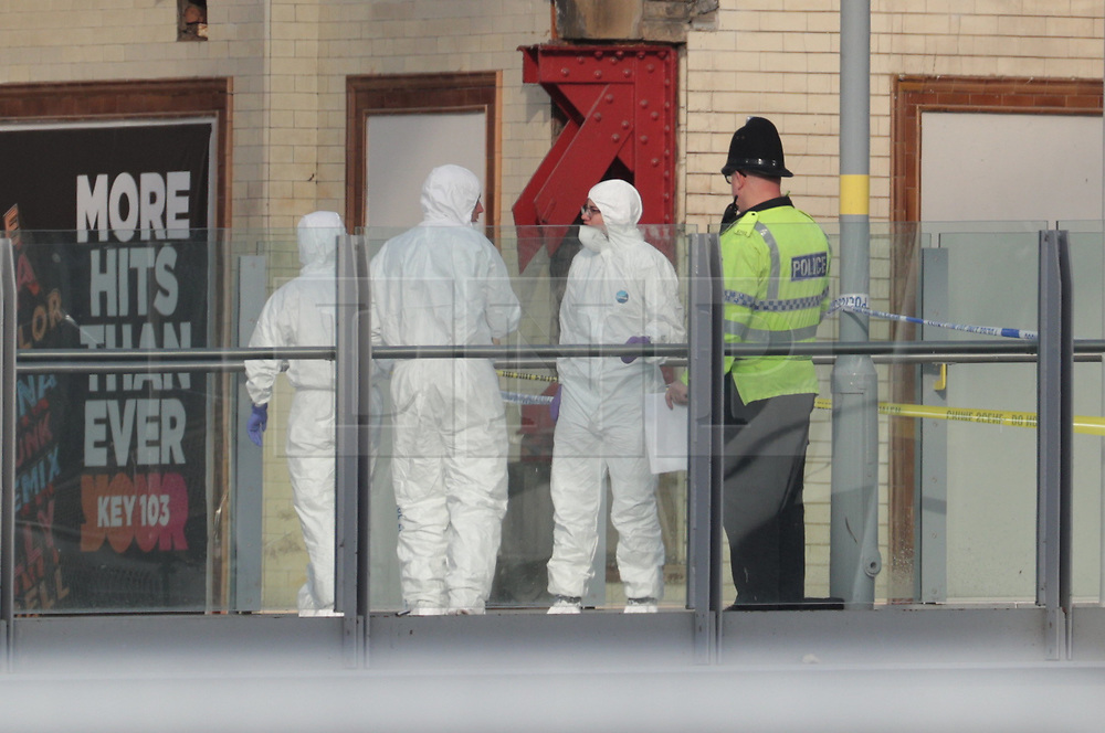 © Licensed to London News Pictures. 23/05/2017. Manchester, UK. Forensic examiners on the walkway that links Victoria Station with the Manchester Arena.  Police and other emergency services are seen near the Manchester Arena after reports of an explosion. Police have confirmed they are responding to an incident during an Ariana Grande concert at the venue. Photo credit: Joel Goodman/LNP