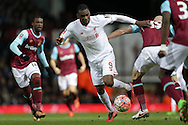 Christian Benteke of Liverpool (c) in action. The Emirates FA cup, 4th round replay match, West Ham Utd v Liverpool at the Boleyn Ground, Upton Park  in London on Tuesday 9th February 2016.<br /> pic by John Patrick Fletcher, Andrew Orchard sports photography.