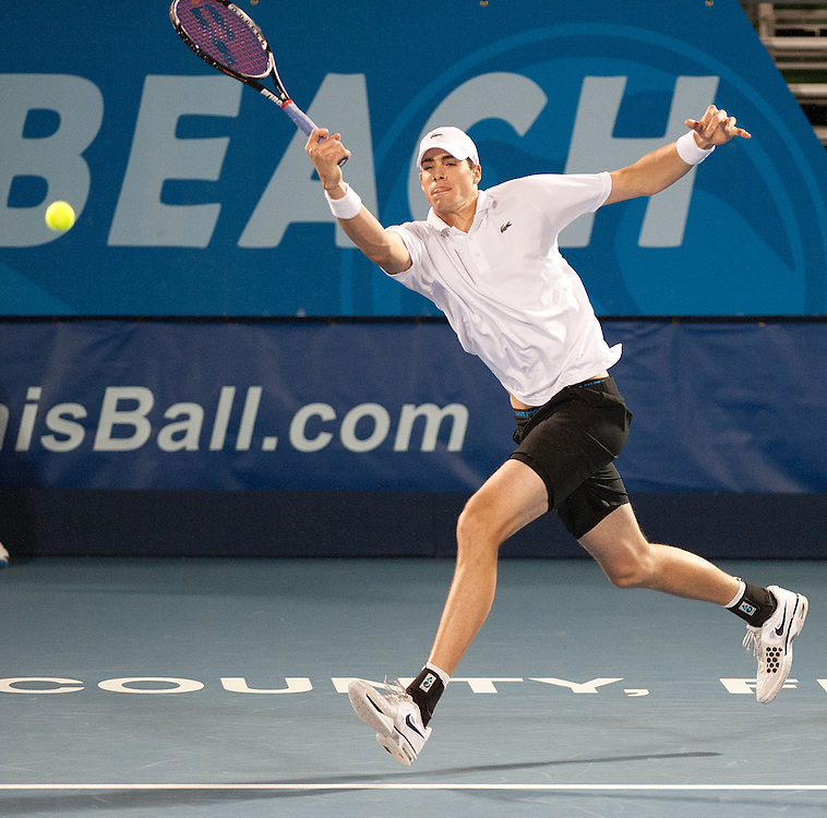 John Isner (USA) in action during his victory over Kevin Anderson (RSA) in their Quarter Final match today - John Isner (USA) def Kevin Anderson (RSA) 6-2 7-6(1)..ATP 250 Tennis - 2012 Delray Beach International Tennis Championships - Day 5 -  Friday 1st March 2013 - Delray Beach Stadium & Tennis Center - Delray Beach - Florida - USA..© CameraSport - 43 Linden Ave. Countesthorpe. Leicester. England. LE8 5PG - Tel: +44 (0) 116 277 4147 - admin@camerasport.com - www.camerasport.com