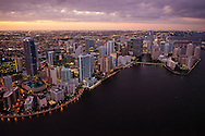 Twilight aerial of downtown Miami featuring the Brickell skyline and Brickell Key.