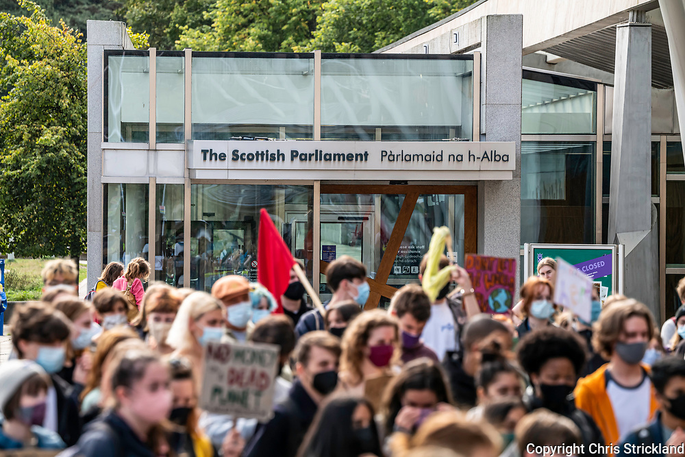 Edinburgh, Lothian, Scotland, UK. 24th September 2021. Around 100 school pupils protested outside the Scottish Parliament under the banner of Fridays4Future, which demands more action from governments on Climate Change. The youth led global movement was conceived by Greta Thunberg, who began protesting outside the Swedish Parliament in 2018. Credit: Chris Strickland
