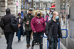 © Licensed to London News Pictures. 13/11/2020. London, UK. Commuters arrive for work in Westminster, London as the economic fallout of the second Covid-19 lockdown continues to hit jobs. Dominic Cummings, Boris Johnson's chief adviser, announced this morning that he will quit by Christmas after Lee Cain, No10's Director of Communications quit yesterday. Photo credit: Alex Lentati/LNP