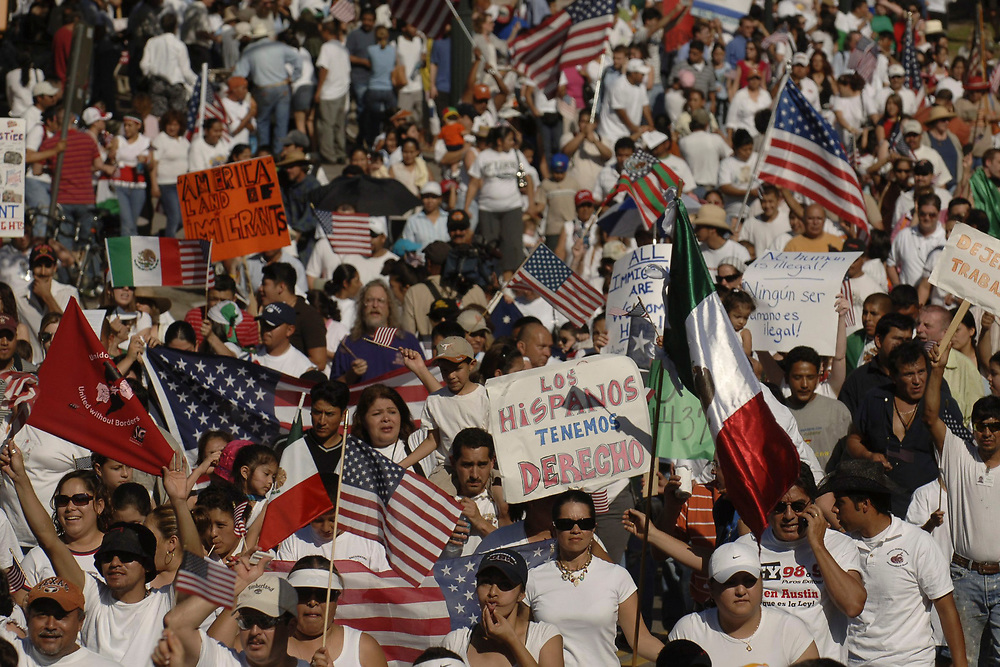 """Austin, TX April 10, 2006: About 20,000 demonstrators march through downtown Austin as immigrant rights supporters staged mass protests nationwide in a """"day of action."""" ©Bob Daemmrich"""
