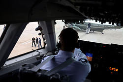President Barack Obama, as viewed from the cockpit, is escorted from Marine One to Air Force One at Joint Base Andrews, Md. for departure en route to Atlanta, Ga., March 10, 2015. (Official White House Photo by Pete Souza)<br /> <br /> This official White House photograph is being made available only for publication by news organizations and/or for personal use printing by the subject(s) of the photograph. The photograph may not be manipulated in any way and may not be used in commercial or political materials, advertisements, emails, products, promotions that in any way suggests approval or endorsement of the President, the First Family, or the White House.