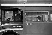 Man on routmaster bus, Victoria Station.<br /> The first Routemasters entered service with London Transport in February 1956 and the last were withdrawn from regular service in December 2005. Coming and Going is a project commissioned by the Museum of London for photographer Barry Lewis in 1976 to document the transport system as it is used by passengers and commuters using public transport by trains, tubes and buses in London, UK.