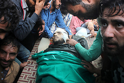 August 3, 2017 - Kulgam, Jammu and Kashmir, India - (EDITORS NOTE: Image depicts death) People surround the dead body of of a slain Kashmiri Young Rebel Aaquib Hamid Itoo at Gopalpora village of Kulgam District, 80 Km from Srinagar. Itoo was killed along with another associate Suhail Ah in a gunfight with forces in Kulgam. (Credit Image: © Muneeb Ul Islam/Pacific Press via ZUMA Wire)