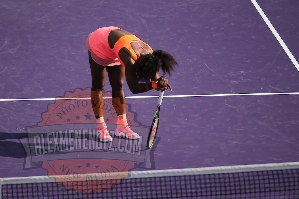 Serena Williams, of the United States, takes a moment to rest during her match against Monica Niculescu, of Romania, at the Miami Open tennis tournament on Saturday, March 28, 2015 in Key Biscayne, Florida. (AP Photo/Alex Menendez)