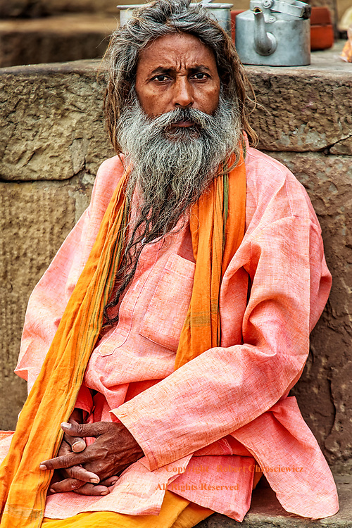 Mornings Wait: A Sadhu bides his time sitting, in his new set of clothes, on the steps of the busy Dashaswamedh Ghat, Varanasi India.