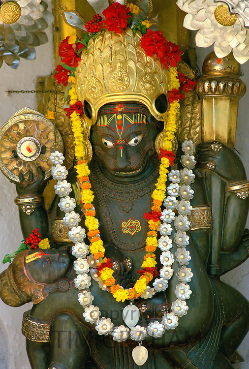 Religious statue adorned with garlands in Kathmandu, Nepal