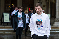 © Licensed to London News Pictures. 20/02/2018. London, UK. TOM EVANS (R), father of ALFIE EVANS, leaves the High Court after a judge ruled that doctors can turn off the life support machine keeping his 21-month-old son alive. Photo credit: Rob Pinney/LNP