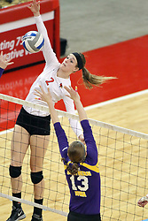 17 October 2014:  Jaelyn Keene smacks the ball towards Kayla Haneline during an NCAA Missouri Valley Conference (MVC) womens volleyball match between the Northern Iowa Panthers and the Illinois State Redbirds for 1st place in the conference at Redbird Arena in Normal IL