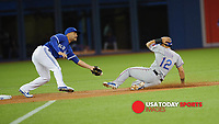 Jun 28, 2015; Toronto, Ontario, CAN; Texas Rangers Texas Rangers Rougned Odor (73) slides into second base before going on to advance to third on a missed catch error by Toronto Blue Jays second baseman Devon Travis (29) in the first inning at Rogers Centre. Blue Jays beat Rangers 3 - 2. Mandatory Credit: Peter Llewellyn-USA TODAY Sports