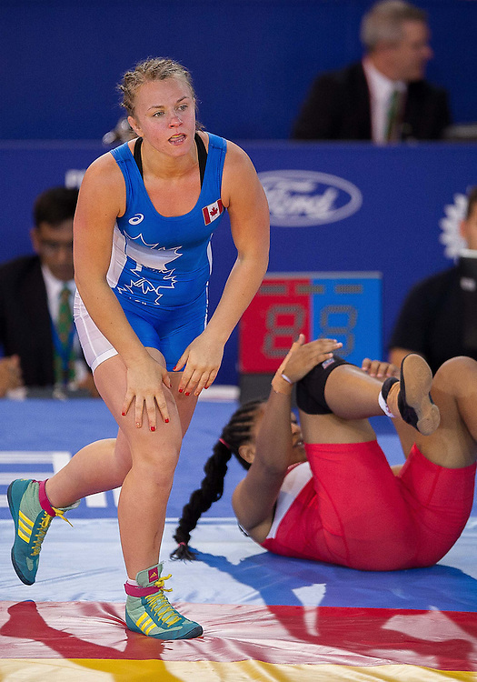 July 29, 2014: Erica Wiebe of Canada (blue) takes on Sophie Edwards (red) of England in the Women's 75kg Nordic Wrestling competition at the Scottish Exhibition Conference Centre during the XX Commonwealth Games in Glasgow, Scotland.