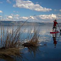 USA, Idaho, Bear Lake. Paddlerboarding on Bear Lake.
