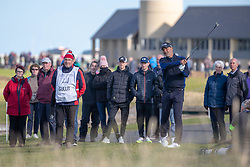 Former footballer Ruud Gullit plays from the rough at the par 4 17th hole during day two of the Alfred Dunhill Links Championship at Carnoustie Golf Links, Angus.