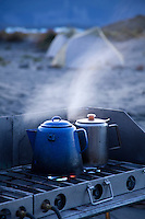 """Coffee and hot water being brewed while on a raft trip down the Tashenshini River. The """"Tat"""" flows out of Yukon, CA, through British Columbia and empties into Glacier Bay National Park in Alaska, US."""