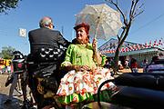 """Lifestyle/Spain. Seville April Fair. A crowd of people attend today the first real day of the """"feria de Abril"""" of Seville. Many women dresses with the traditional costume of """"Flamenca"""" and the people walk,  dance """"sevillanas"""" (typical sevilian dance) and drink """"rebujito"""" (typical drink of the """"Feria de Abril"""" made by the youngdry wine """"Manzanilla""""  and carbonated drink...Una multitud de personas asisten hoy al primer día real de la feria de Abril de Sevilla. Muchas mujeres se visten con el traje tradicional de """"flamenca"""" y pasean por el recinto ferial mientras bailan, beben """"rebujito"""" (bebida típica de la feri de Abril hecha de """"Manzanilla"""" y bebida gaseosa y montan a caballo o en carruaje."""