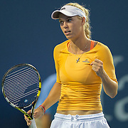 August 16, 2014, New Haven, CT:<br /> Caroline Wozniacki reacts during a match against Timea Bacsinszky on day four of the 2014 Connecticut Open at the Yale University Tennis Center in New Haven, Connecticut Monday, August 18, 2014.<br /> (Photo by Billie Weiss/Connecticut Open)