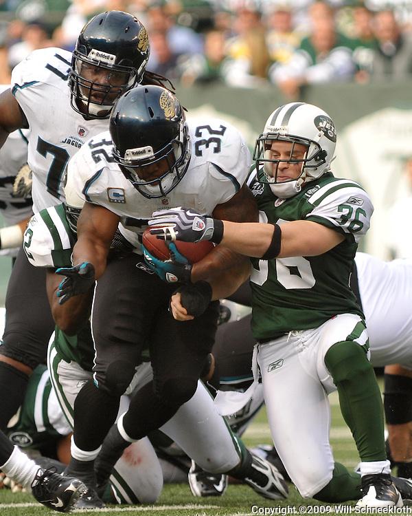 Nov 15, 2009; East Rutherford, NJ, USA; New York Jets safety Jim Leonhard (36) wraps up Jacksonville Jaguars running back Maurice Jones-Drew (32) during first half NFL action between the New York Jets and Jacksonville Jaguars at Giants Stadium.