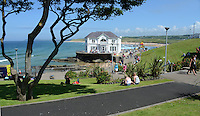 GV, general view, Arcadia, Portrush, Co Antrim, N Ireland, UK. 201406213157<br /> <br /> Copyright Image from Victor Patterson, 54 Dorchester Park, Belfast, UK, BT9 6RJ<br /> <br /> t1: +44 28 9066 1296 (from Rep of Ireland 048 9066 1296)<br /> t2: +44 28 9002 2446 (from Rep of Ireland 048 9002 2446)<br /> m: +44 7802 353836<br /> <br /> victorpattersonbelfast@gmail.com<br /> www.victorpatterson.com<br /> <br /> Please see my Terms and Conditions of Use at http://www.c1382010.myzen.co.uk/pdf/Terms%20&%20Conditions.pdf  It is IMPORTANT that you familiarise yourself with them.<br /> <br /> Images used on the Internet incur an additional cost and must be visibly watermarked i.e. ©Victor Patterson within the body of the image and copyright metadata must not be deleted. Images used on the Internet have a size restriction of 4kbs and are chargeable at rates available at victorpattersonbelfast@gmail.com.<br /> <br /> This image is only available for the use of the download recipient i.e. television station, newspaper, magazine, book publisher, etc, and must not be passed on to any third party. It is also downloaded on condition that each and every usage is notified within 7 days to victorpattersonbelfast@gmail.com.<br /> <br /> The right of Victor Patterson to be identified as the author is asserted in accordance with The Copyright Designs And Patents Act (1988). All moral rights are asserted.