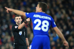 25 November 2017 -  Premier League - Liverpool v Chelsea - Referee Michael Oliver points at Cesar Azpilicueta of Chelsea asking him to leave the pitch for treatment - Photo: Marc Atkins/Offside