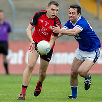 Clondegad's Cormac Ryan is pulled back by  Cratloe's Conor McGrath