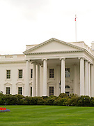 View of the White House, 1600 Pennsylvania Avenue, Washington, DC, through the front fence on an overcast morning.