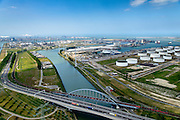 Nederland, Zuid-Holland, Rotterdam, 10-06-2015; Europoort, Dintelhavenbruggen over Hartelkanaal en Dintelhaven. Betuweroute en A15, op de spoorbrug een goederentrein. Rechts Shell Europoort terminal, Beneluxhaven met P&O terminal, BP Rafiinaderij en Maasvlakte aan de horizon.<br /> Industrial landscape in Port of Rotterdam with bridges, roads, railroads.<br /> <br /> luchtfoto (toeslag op standard tarieven);<br /> aerial photo (additional fee required);<br /> copyright foto/photo Siebe Swart