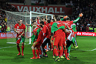 Gareth Bale of Wales (l) leads the celebrations   after the match as the Wales team qualify for Euro 2016 finals in France.  Wales v Andorra, Euro 2016 qualifying match at the Cardiff city stadium  in Cardiff, South Wales  on Tuesday 13th October 2015. <br /> pic by  Andrew Orchard, Andrew Orchard sports photography.