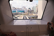 Tourists enjoy a ride in an automated Miami Metromover rail car as downtown Miami's shopping and commercial district looms in the car's front window. WATERMARKS WILL NOT APPEAR ON PRINTS OR LICENSED IMAGES.