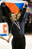 KELOWNA, BC - OCTOBER 26: Pairs gold medalist Dmitrii Kozlovskii of Russia skates with the flag on the ice during medal ceremonies of Skate Canada International held at Prospera Place on October 26, 2019 in Kelowna, Canada. (Photo by Marissa Baecker/Shoot the Breeze)