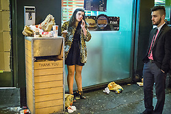© Licensed to London News Pictures . 01/01/2015 . Manchester , UK . Rubbish strewn on the pavement outside McDonalds on Oxford Road . Revellers usher in the New Year on a night out in Manchester City Centre .  Photo credit : Joel Goodman/LNP