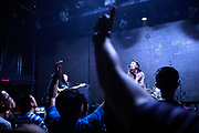 A folk rock band performs at Mao Livehouse in Shanghai, China on Oct. 14, 2011.  Rock and roll remains a fringe genre of music in China, a country dominated by pop music, despite seeing a surge of popularity during the 80's and 90's.