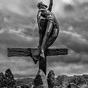 One of the masterful and detailed stations of the cross by sculptor Huberto Maestas outside the Chapel of All Saints in San Luis, Colorado. This final station depicting Jesus' resurrection is powerful and moving, no matter your faith or spirituality.