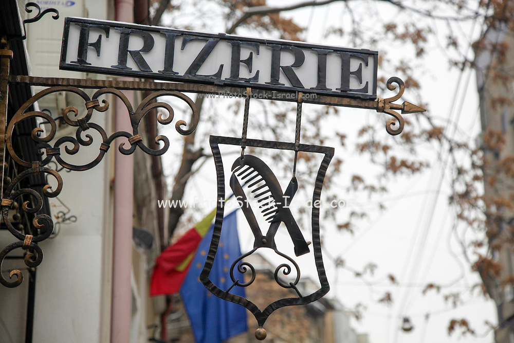 Frizerie - barbershop sign in Bucharest, Romania