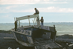 Boys Playing On Beached Boat