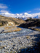 View of the Torlesse Range looking up  the Broken River along Highway 73, New Zealand.