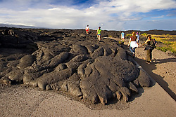 Park visitors and hikers walking over Pahoehoe lava from 1992 to 2003 eruption which devastated Chain of Craters Road, Hawaii, USA Volcanoes National Park, Kilauea, Big Island, Hawaii, USA
