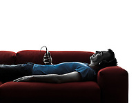 one caucasian man sofa couch listening music audio  in silhouette isolated on white background