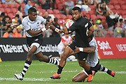 New Zealand's Jona Nareki is tackled during the HSBC Singapore Rugby Sevens Cup Quarter Final - Fiji v New Zealand   won by Fiji 19-5 at The National Stadium, Singapore, Sunday, April 14th, 2019. (Steve Flynn/Image of Sport)