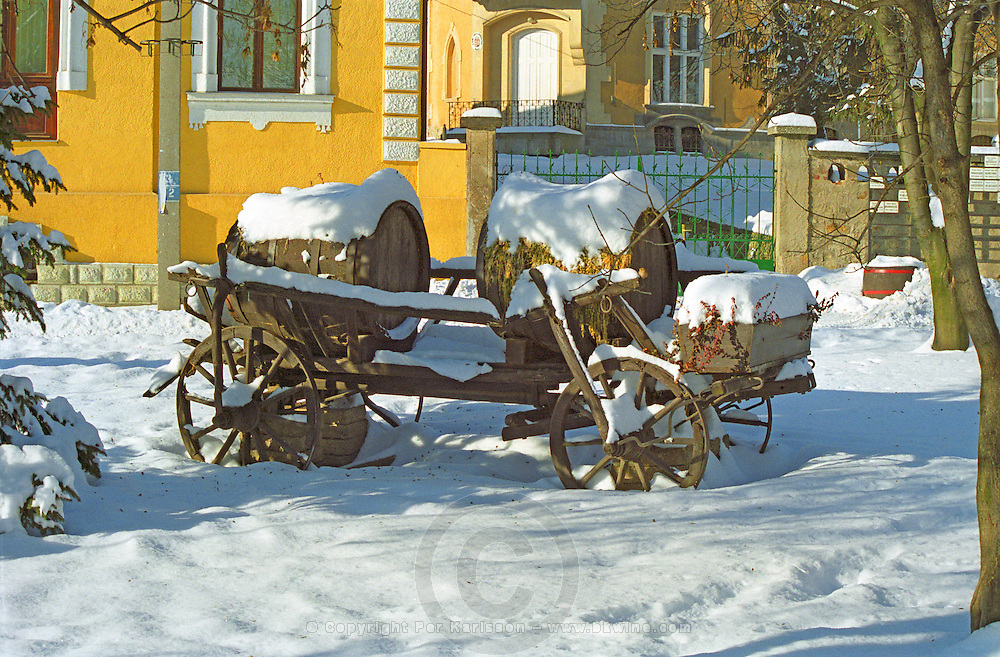 In the Tokaj village Mad: an old horse drawn cart carrying wine barrels, today used for decoration in the village square in the snow. Mad is one of the main villages in the Tokaj district.  Credit Per Karlsson BKWine.com