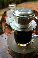 Vietnamese coffee filter.  Though it takes a long time for the coffee to filter through the typical Vietnamese coffee filtering system, the wait is usually worth it.  In fact it is rather fun to watch the liquid slowly dripping high octane caffeine into your cup.