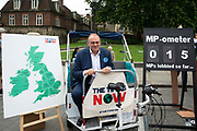 Sir Ed Davey, Liberal Democrat MP sits in a rickshaw at a climate change protest in Westminster, Central London, United Kingdom on 26th June 2019. Organisers of the Time is Now mass lobby demand politicians end the UKs contribution to climate change.