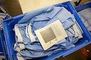 Blue uniform boxer shorts material sits in a blue box in the workshop in the Industries Department in Her Majesty's Prison Pentonville, London, United Kingdom.  Prisoners are encouraged to work or take courses to learn new skills to help rehabilitation and reduce re-offending rates on their release. (Photo by Andy Aitchison)