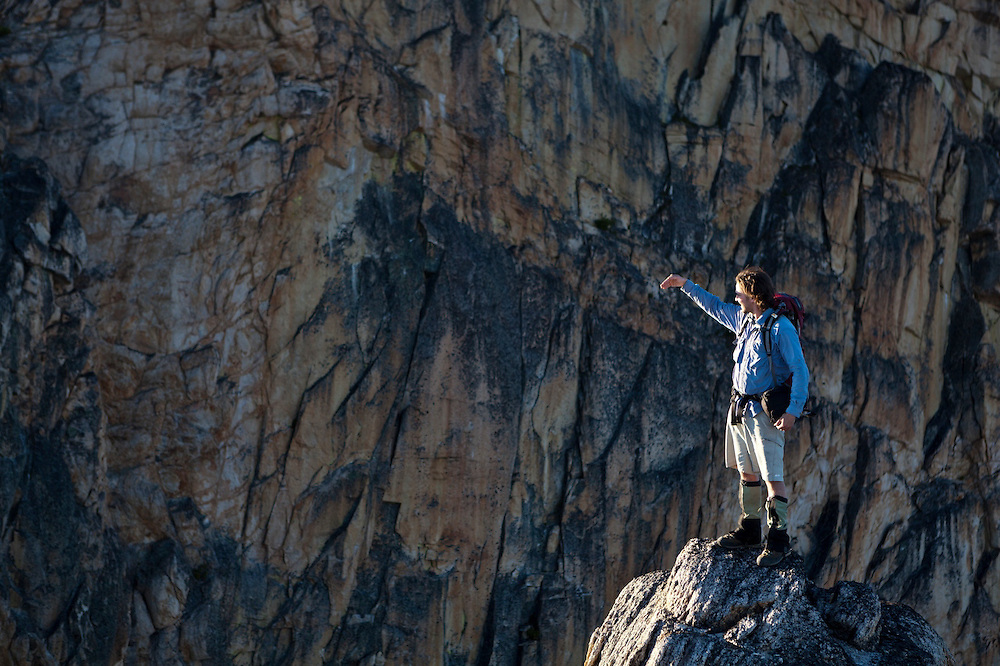 Kevin Steffa looks out from a rock spire against the East Face of Golden Horn, Okanogan National Forest, Washington.