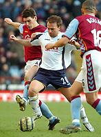 Photo: Ed Godden.<br />Aston Villa v Portsmouth. The Barclays Premiership. 04/03/2006. <br />Gareth Barry (L) and Onjen Koroman battle.