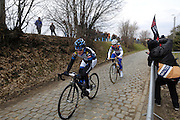 Belgium, March 31 2013: Elisa Longo Borghini, HITEC PRODUCTS UCK, and eventual winner Marianne Vos, RABO WOMEN CYCLING TEAM on the Oude-Kwaremont climb in the women's Ronde van Vlaandaren 2013 race. Copyright 2013 Peter Horrell.