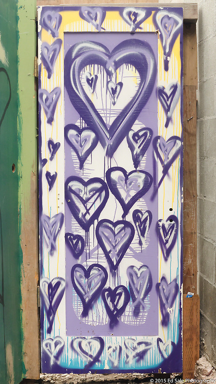 Painted doors with social commentary that once formed wall around homeless encampment in southwest Portland, Oregon