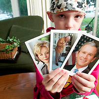 (PPAGE1) Pt. Pleasant 9/9/2004  Carly Roncin was diagnosed with a rare and aggressive type of brain cancer.  We are revisiting how she and her dog Jack are doing. Here she holds some of the photos sent to her by Laura Bush from the White House.   Michael J. Treola Staff Photographer.....MJT